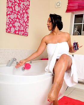Hot MILF Danica slips into a nice hot bubble bath
